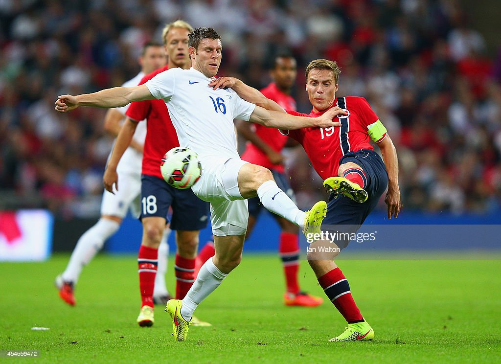 James Milner of England (L) goes in for a challenge with Ruben Yttergard Jenssen of Norway during the International friendly match between England and Norway at Wembley Stadium on September 3, 2014 in London, England.