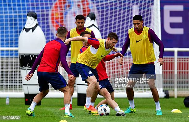 James Milner of England holds off Gary Cahill of England during a training session at Stade du Bourgognes ahead of the UEFA Euro 2016 match against...