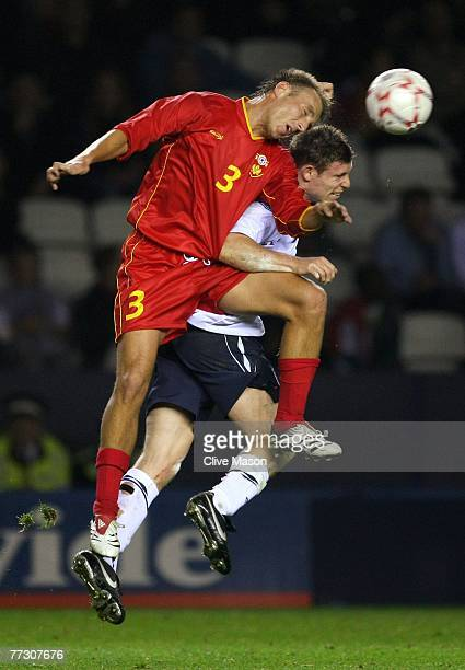 James Milner of England is challenged by Blazo Igumanovic of Montenegro during the 2009 UEFA U21 Championship Qualifying match between England and...