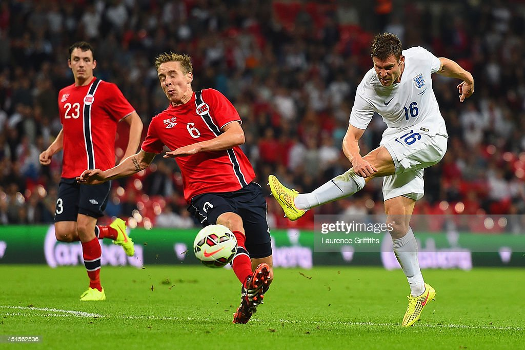 James Milner of England shoots past Stefan Johansen of Norway during the International friendly match between England and Norway at Wembley Stadium on September 3, 2014 in London, England.
