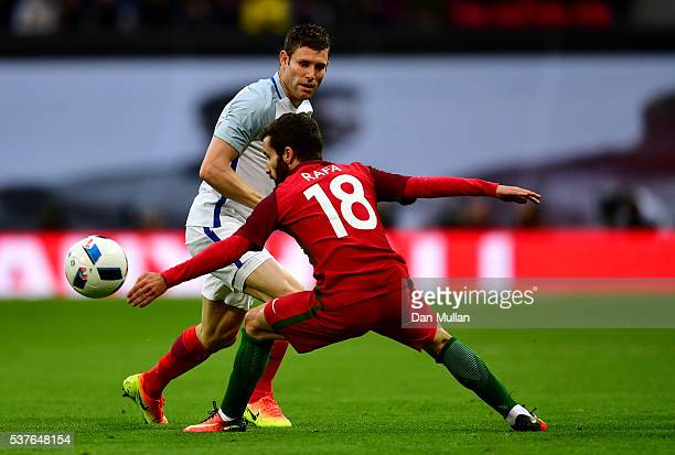 James Milner of England takes on Rafa Silva of Portugal during the international friendly match between England and Portugal at Wembley Stadium on...