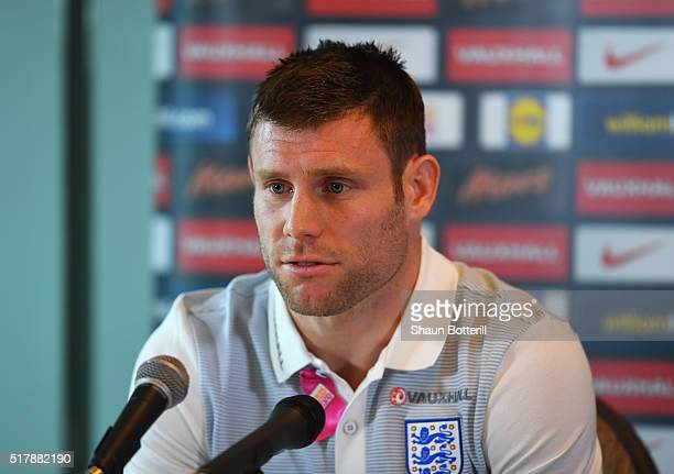 James Milner of England talks during a press conference prior to the International Friendly match against the Netherlands at the Grove Hotel on March...