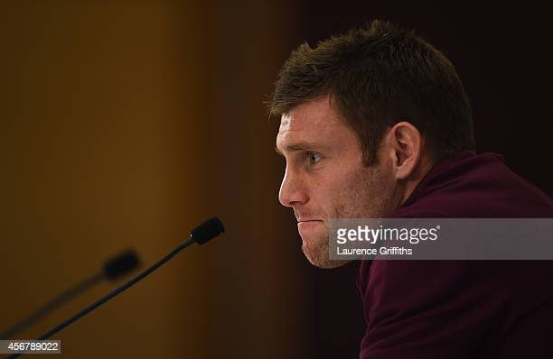 James Milner of England talks to the media during a Press Conference at St Georges Park on October 7 2014 in BurtonuponTrent England