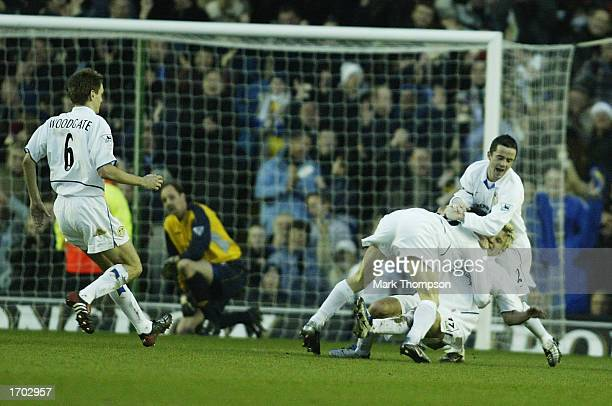 James Milner of Leeds celebrates with Gary Kelly and Alan Smith after scoring the second goal during the Leeds United v Chelsea FA Barclaycard...