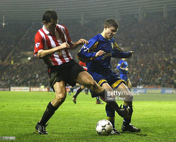 James Milner of Leeds is tackled by Kevin Kilbane of Sunderland during the FA Barclaycard Premiership match between Sunderland and Leeds United at...