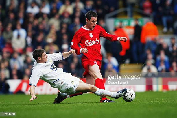 James Milner of Leeds United tackles Steve Finnan of Liverpool during the FA Barclaycard Premiership match between Liverpool and Leeds on October 25,...
