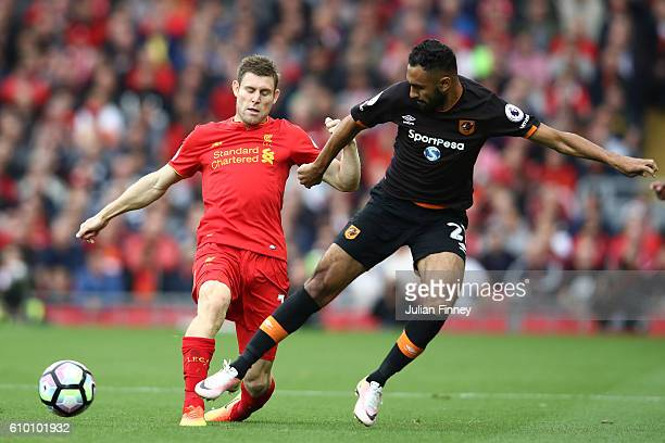 James Milner of Liverpool and Ahmed Elmohamady of Hull City battle for possession during the Premier League match between Liverpool and Hull City at...