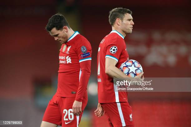 James Milner of Liverpool and Andrew Robertson of Liverpool look dejected during the UEFA Champions League Group D stage match between Liverpool FC...