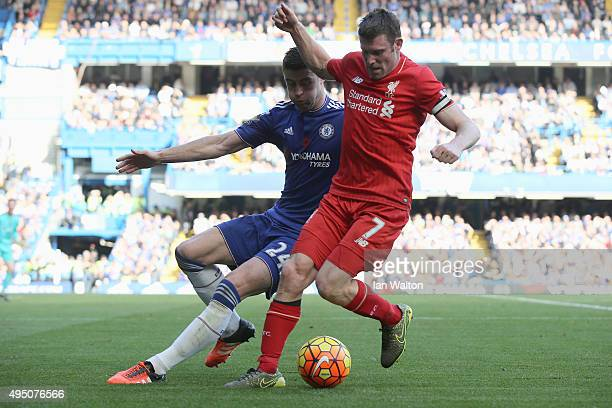James Milner of Liverpool and Gary Cahill of Chelsea compete for the ball during the Barclays Premier League match between Chelsea and Liverpool at...