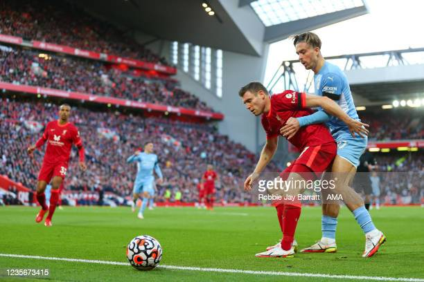 James Milner of Liverpool and Jack Grealish of Manchester City during the Premier League match between Liverpool and Manchester City at Anfield on...