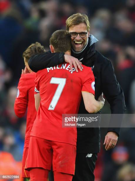James Milner of Liverpool and Jurgen Klopp Manager of Liverpool embrace after the Premier League match between Liverpool and Burnley at Anfield on...
