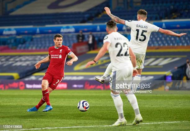 James Milner of Liverpool and Stuart Dallas of Leeds United in action during the Premier League match between Leeds United and Liverpool at Elland...