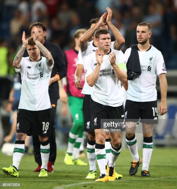 James Milner of Liverpool and team celebrate after the final whistle during the UEFA Champions League Qualifying PlayOffs Round First Leg match...
