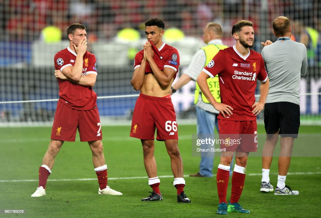 James Milner of Liverpool and Trent Alexander-Arnold of Liverpool look dejected following their sides defeat in the UEFA Champions League Final between Real Madrid and Liverpool at NSC Olimpiyskiy Stadium on May 26, 2018 in Kiev, Ukraine.