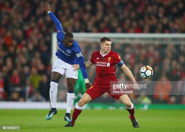 James Milner of Liverpool and Yannick Bolasie battle for the ball during the Emirates FA Cup Third Round match between Liverpool and Everton at...