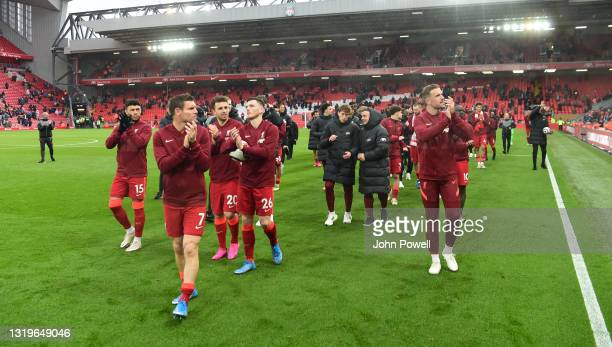 James Milner of Liverpool Andy Robertson of Liverpool Diogo Jota of Liverpool Jordan Henderson captain of Liverpool Alex Oxlade-Chamberlain of...
