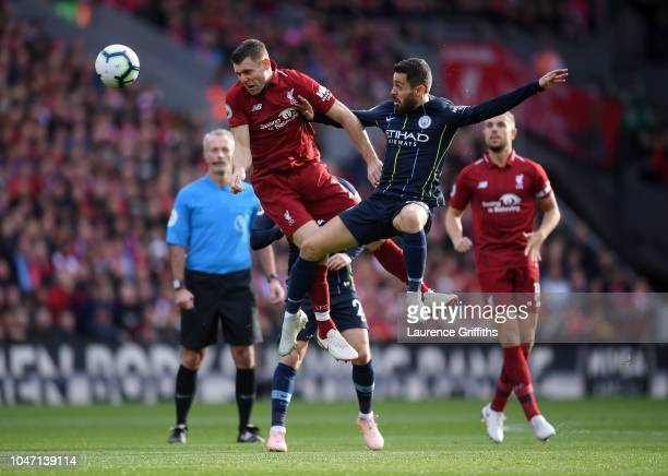 James Milner of Liverpool battles for possession with Bernardo Silva of Manchester City during the Premier League match between Liverpool FC and...