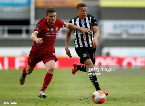 James Milner of Liverpool battles for possession with Dwight Gayle of Newcastle United during the Premier League match between Newcastle United and...