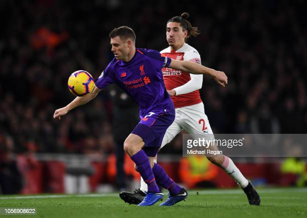 James Milner of Liverpool battles for possession with Hector Bellerin of Arsenal during the Premier League match between Arsenal FC and Liverpool FC...