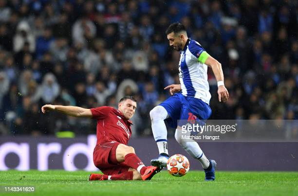 James Milner of Liverpool battles for possession with Hector Herrera of FC Porto during the UEFA Champions League Quarter Final second leg match...