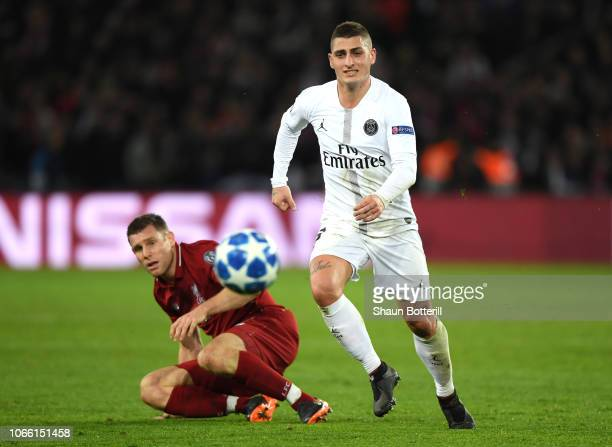 James Milner of Liverpool battles for possession with Marco Verratti of Paris SaintGermain during the UEFA Champions League Group C match between...