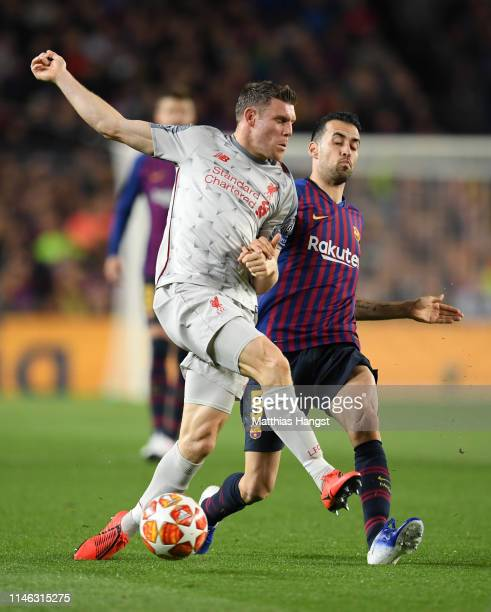 James Milner of Liverpool battles for possession with Sergio Busquets of Barcelona during the UEFA Champions League Semi Final first leg match...