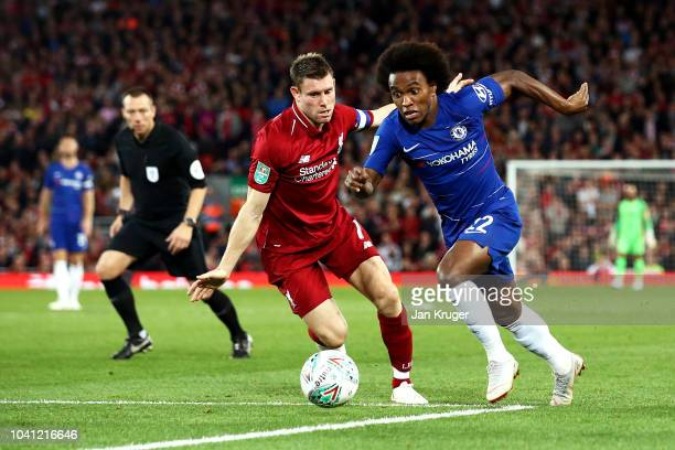 James Milner of Liverpool battles for possession with Willian of Chelsea during the Carabao Cup Third Round match between Liverpool and Chelsea at...