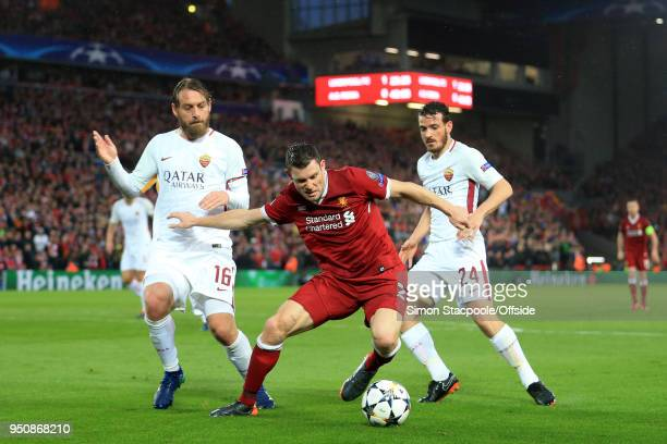 James Milner of Liverpool battles with Daniele De Rossi of Roma and Alessandro Florenzi of Roma during the UEFA Champions League Semi Final First Leg...
