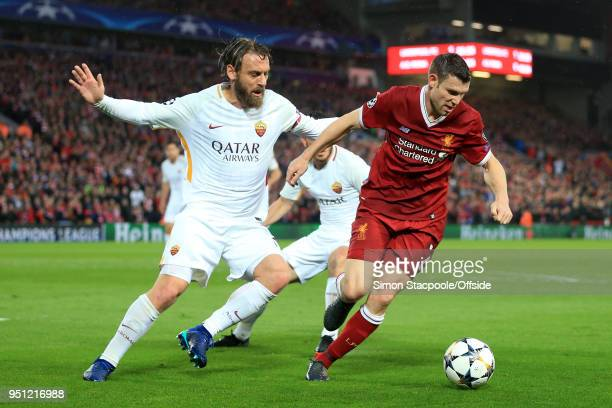 James Milner of Liverpool battles with Daniele De Rossi of Roma during the UEFA Champions League Semi Final First Leg match between Liverpool and AS...