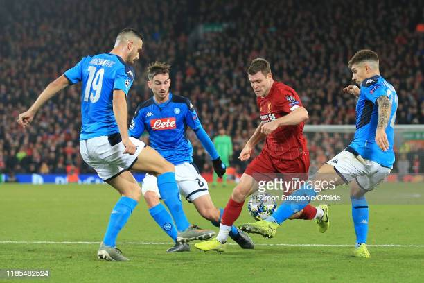 James Milner of Liverpool battles with Nikola Maksimovic of Napoli Fabian of Napoli and Giovanni Di Lorenzo of Napoli during the UEFA Champions...