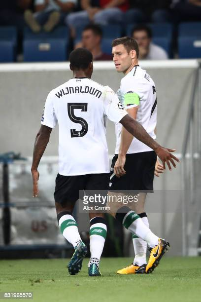 James Milner of Liverpool celebrates after he scored with Georgino Wijnaldum during the UEFA Champions League Qualifying PlayOffs Round First Leg...