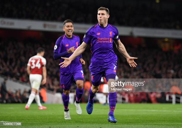 James Milner of Liverpool celebrates after he scores his sides first goal during the Premier League match between Arsenal FC and Liverpool FC at...
