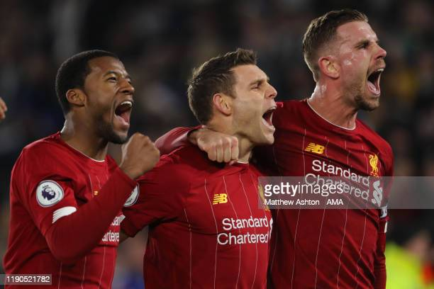 James Milner of Liverpool celebrates after scoring a goal to make it 0-2 with Georginio Wijnaldum and Jordan Henderson during the Premier League...