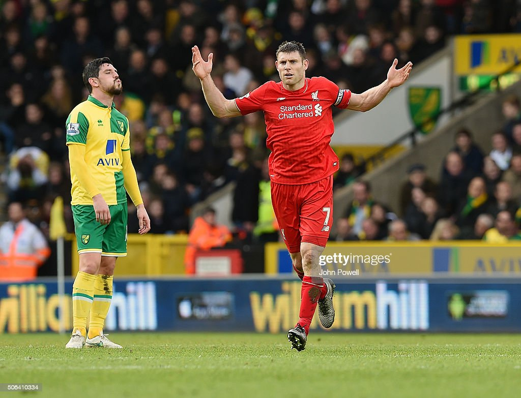 James Milner of Liverpool celebrates after scoring by encouraging the fans during the Barclays Premier League match between Norwich City and Liverpool at Carrow Road on January 23, 2016 in Norwich, England.
