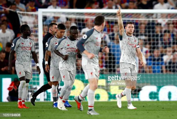 James Milner of Liverpool celebrates after scoring his sides first goal during the Premier League match between Crystal Palace and Liverpool FC at...