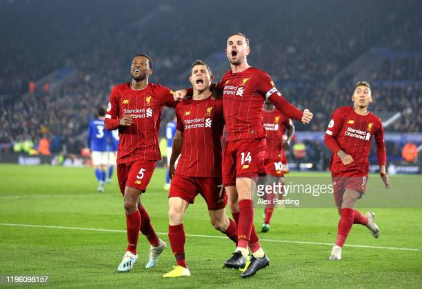 James Milner of Liverpool celebrates after scoring his sides second goal with Jordan Henderson and Georginio Wijnaldum during the Premier League...