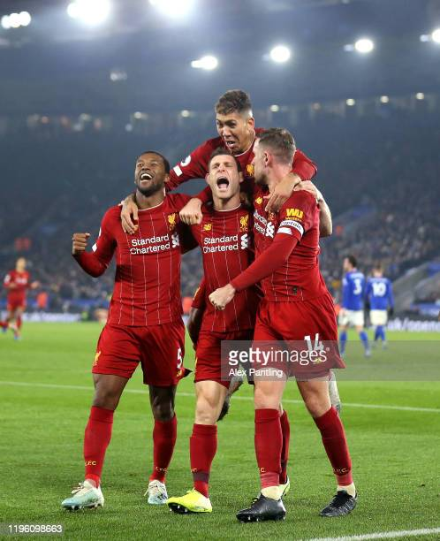 James Milner of Liverpool celebrates after scoring his sides second goal with Roberto Firminho Jordan Henderson and Georginio Wijnaldum during the...