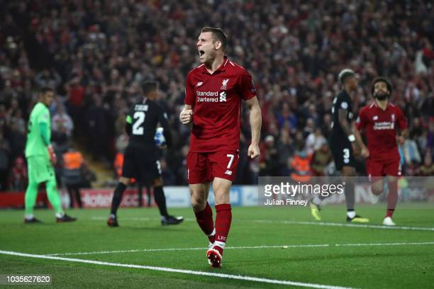 James Milner of Liverpool celebrates after scoring his team's second goal during the Group C match of the UEFA Champions League between Liverpool and...