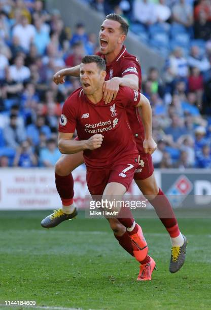 James Milner of Liverpool celebrates after scoring his team's second goal with teammate Jordan Henderson during the Premier League match between...