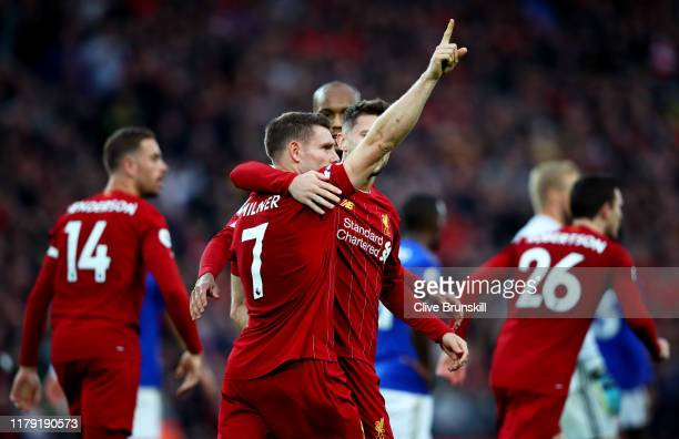 James Milner of Liverpool celebrates after scoring his team's second goal during the Premier League match between Liverpool FC and Leicester City at...