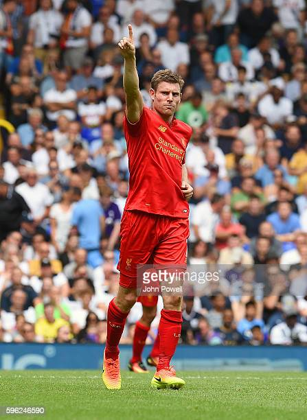 James Milner of Liverpool celebrates after scoring the opening goal from the penalty spot during the Premier League match between Tottenham Hotspur...