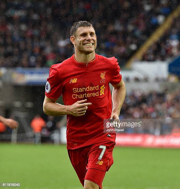 James Milner of Liverpool celebrates after scoring the winning goal during the Premier League match between Swansea City and Liverpool at Liberty...