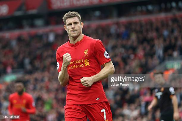 James Milner of Liverpool celebrates as he scores his sides fifth goal during the Premier League match between Liverpool and Hull City at Anfield on...