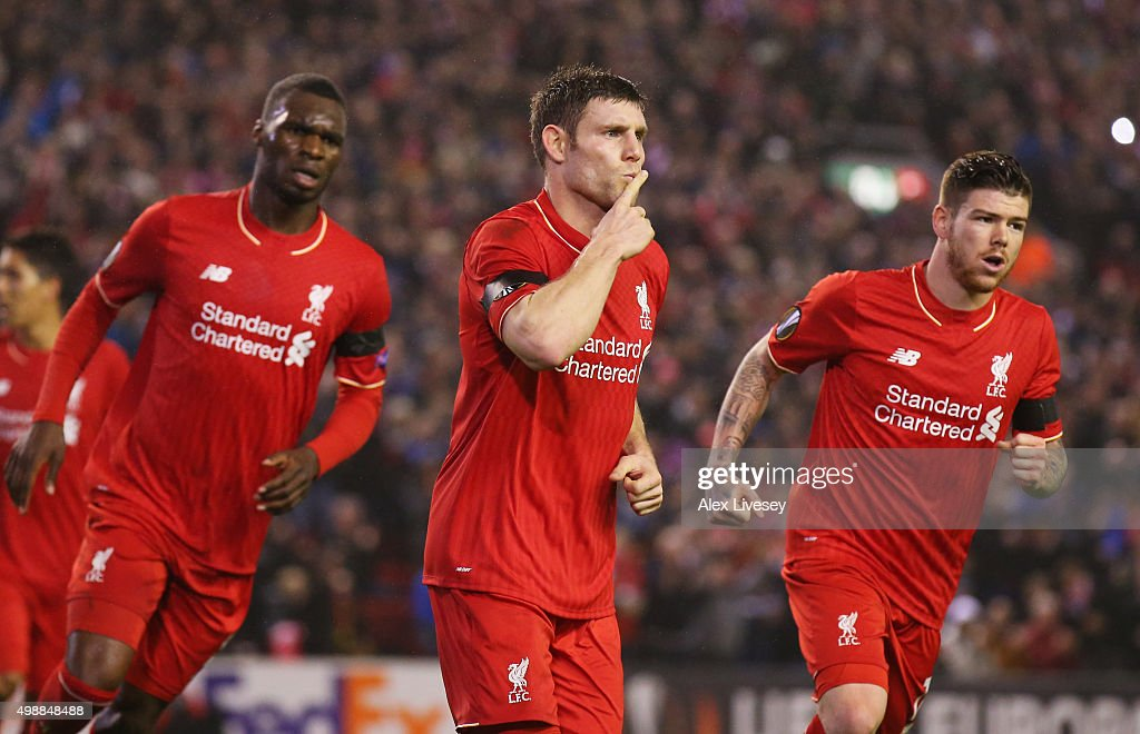 James Milner of Liverpool (C) celebrates as he scores their first and equalising goal from the penalty spot with Christian Benteke (L) and Alberto Moreno (R) during the UEFA Europa League Group B match between Liverpool FC and FC Girondins de Bordeaux at Anfield on November 26, 2015 in Liverpool, United Kingdom.