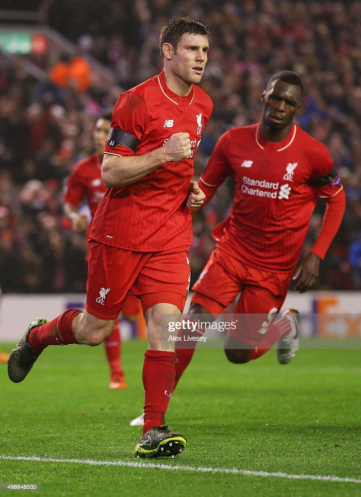James Milner of Liverpool (L) celebrates as he scores their first and equalising goal from the penalty spot with Christian Benteke (R) during the UEFA Europa League Group B match between Liverpool FC and FC Girondins de Bordeaux at Anfield on November 26, 2015 in Liverpool, United Kingdom.