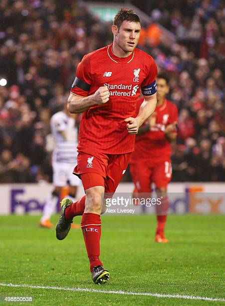 James Milner of Liverpool celebrates as he scores their first and equalising goal from the penalty spot during the UEFA Europa League Group B match...