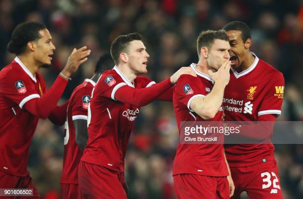 James Milner of Liverpool celebrates as he scores their first goal from the penalty spot with team mates during the Emirates FA Cup Third Round match...