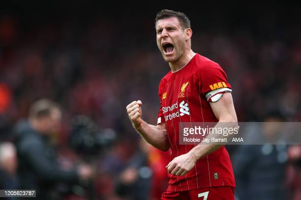 James Milner of Liverpool celebrates at full time during the Premier League match between Liverpool FC and AFC Bournemouth at Anfield on March 7,...