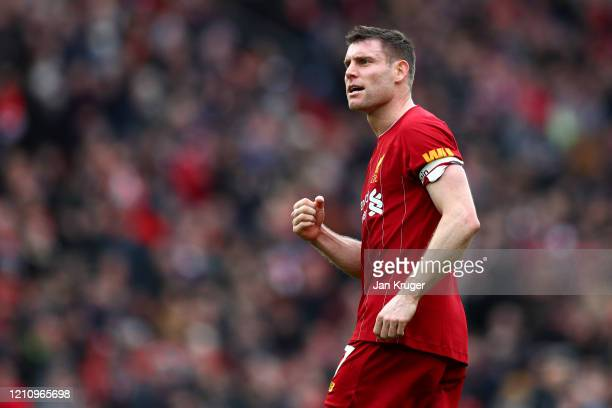 James Milner of Liverpool celebrates following his sides victory in the Premier League match between Liverpool FC and AFC Bournemouth at Anfield on...