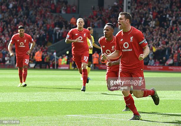 James Milner of Liverpool celebrates his goal during the Barclays Premier League match between Liverpool and Aston Villa on September 26 2015 in...